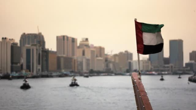flag of dubai, united arab emirates (uae) on boat - flag stock videos & royalty-free footage