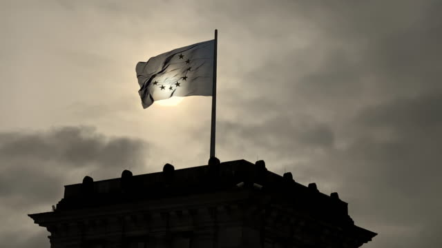 flag of european union blows proudly in the wind, on the reichstag in berlin. - 1933 stock videos & royalty-free footage