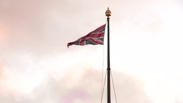 flag of great britain waving over westminster palace in london - pole stock videos & royalty-free footage