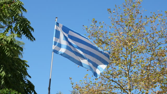 flag of greece blowing in the wind - greek flag stock videos & royalty-free footage