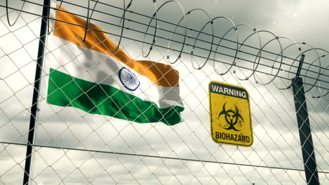 flag of india with biohazard sign warning of quarantine. loopable. - fence stock videos & royalty-free footage