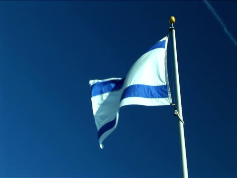 ms, flag of israel flapping against clear sky - israel stock videos & royalty-free footage
