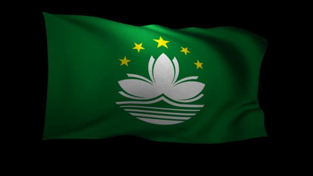 cgi flag of macau waving against black background - macao flag stock videos and b-roll footage