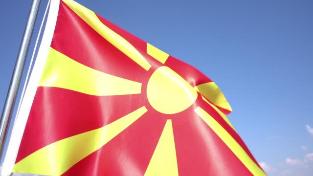 bandiera di macedonia - grecia stato video stock e b–roll