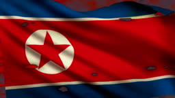 Flag of North Korea waving at battlefield