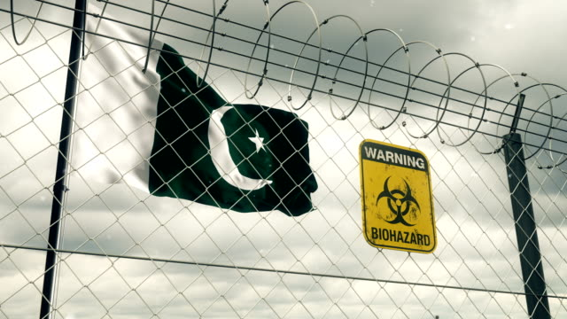 flag of pakistan with biohazard sign warning of quarantine. loopable. - pakistan stock videos & royalty-free footage