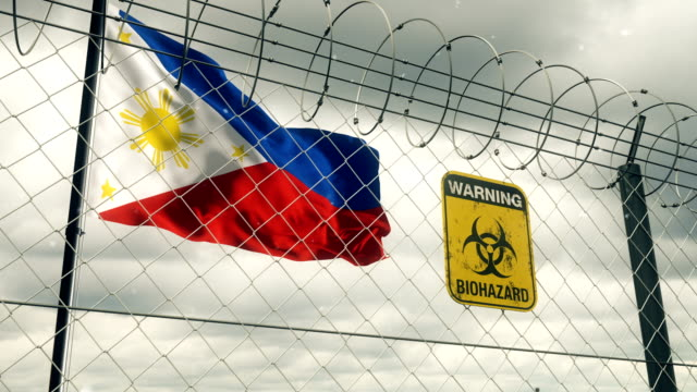 flag of philippines with biohazard sign warning of quarantine. loopable. - philippines flag stock videos & royalty-free footage