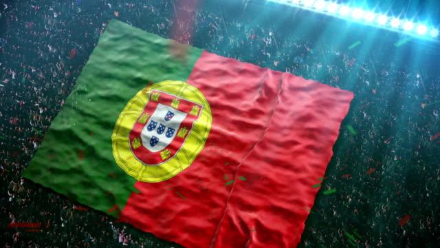 vídeos de stock e filmes b-roll de bandeira de portugal, no estádio - bola de futebol americano bola