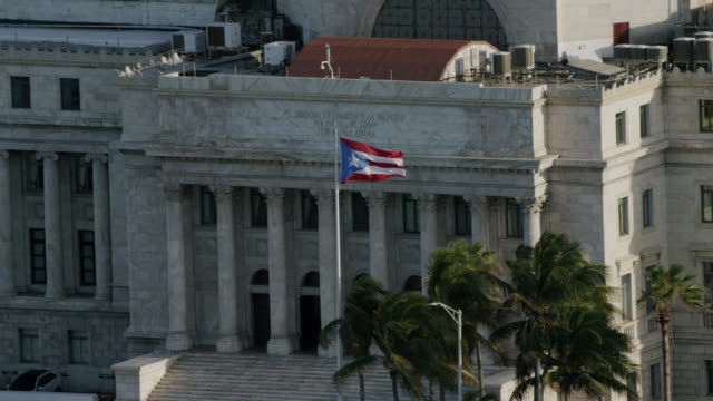 ws aerial pov flag of puerto rico waving outside capitol building of puerto rico / old san juan, san juan, puerto rico, united states - puerto rico stock videos and b-roll footage