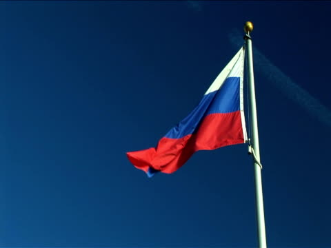 ms, la, flag of russia flapping against clear sky - russian flag stock videos & royalty-free footage