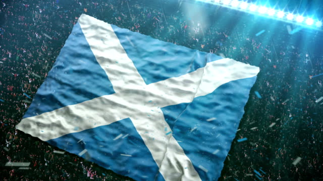 flag of scotland at the stadium - scottish culture stock videos & royalty-free footage