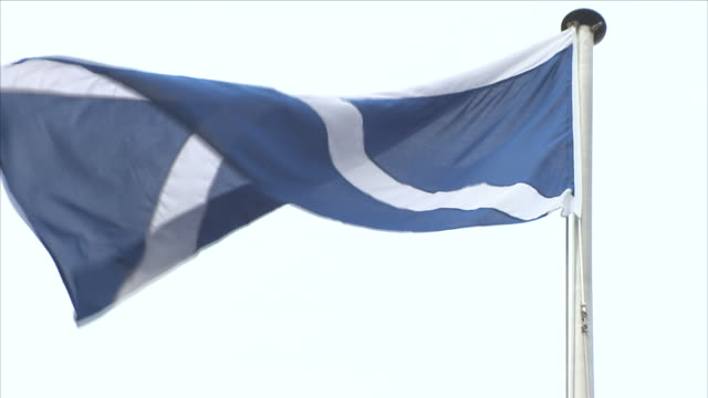 flag of scotland blowing in the wind - scottish flag stock videos & royalty-free footage
