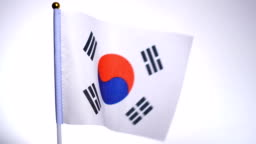 Flag of South Korea on flagpole flying and waving in the wind.