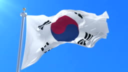 Flag of South Korea waving at wind with blue sky, loop