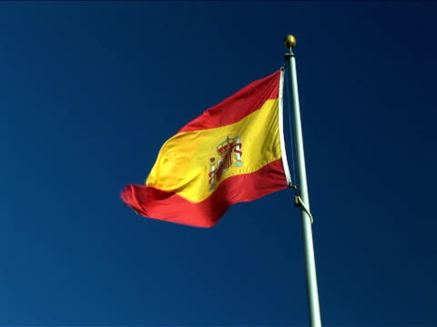 ms, flag of spain flapping against clear sky - spanish flag stock videos and b-roll footage