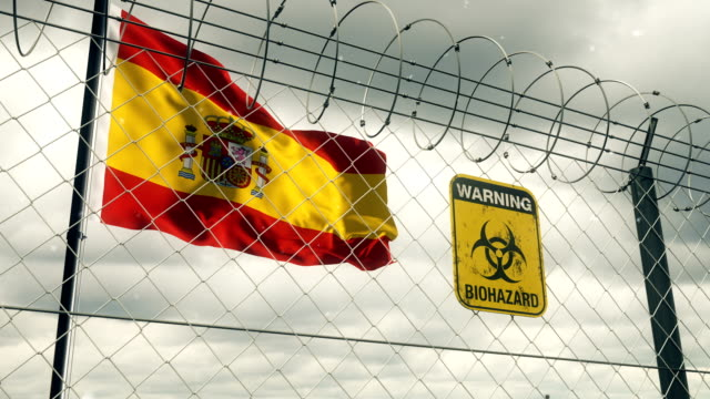 flag of spain with biohazard sign warning of quarantine. loopable. - biohazard symbol stock videos & royalty-free footage