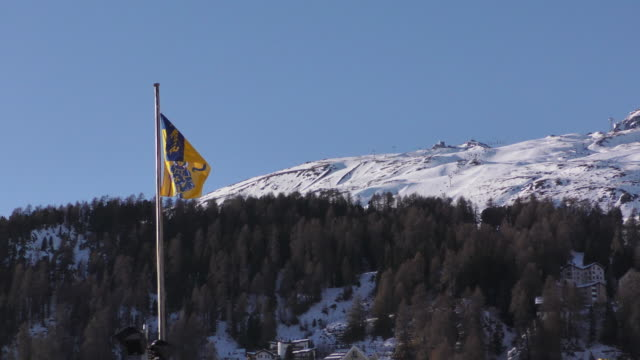 Flag of St Moritz on winter landscape NO