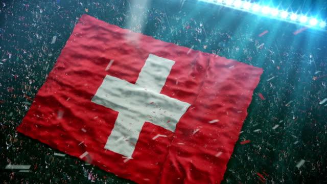 stockvideo's en b-roll-footage met flag of switzerland at the stadium - zwitserland