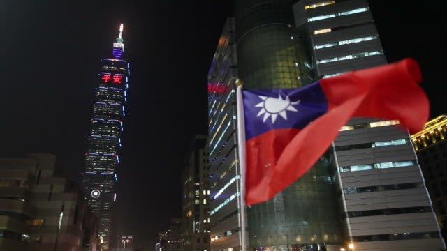 ws la flag of taiwan fluttering in front of office buildings / taipei, taiwan - taipei 101 stock videos & royalty-free footage