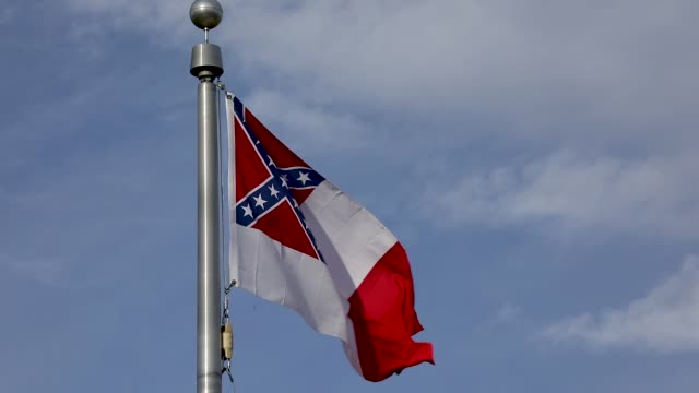 a flag of the confederate states of america flies near the gravesite of jefferson davis former president of the confederate states of america at... - confederate flag stock videos and b-roll footage