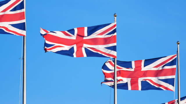 4k flag of the united kingdom, england - bandiera del regno unito video stock e b–roll