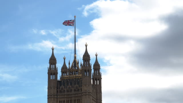 flag of the united kingdom waving on houses of parliament - 19th century style stock videos & royalty-free footage