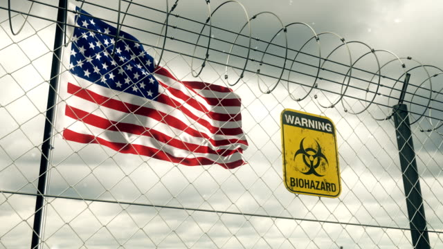flag of the united states with biohazard sign warning of quarantine. loopable. - biohazard symbol stock videos & royalty-free footage