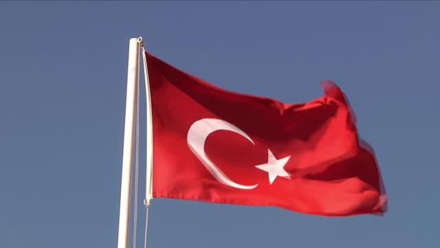 flag of turkey blowing in the wind - トルコ国旗点の映像素材/bロール