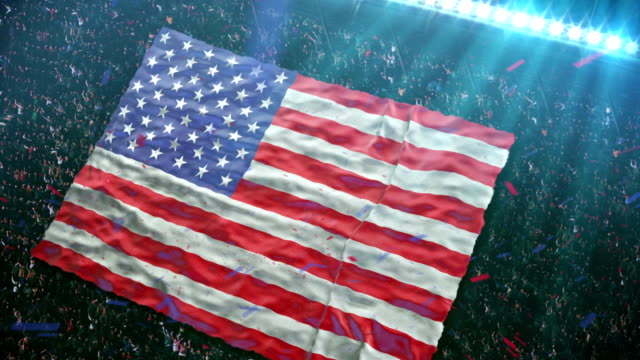 flag of usa at the stadium - patriotism stock videos & royalty-free footage