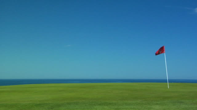 ms, flag on golf course, north truro, massachusetts, usa - 旗点の映像素材/bロール