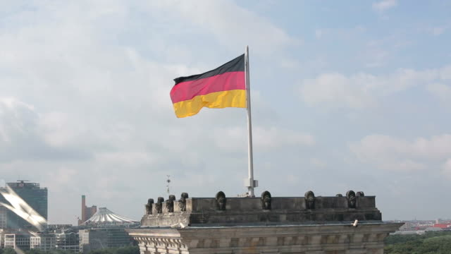 flag on reichstag in berlin - german flag stock videos & royalty-free footage