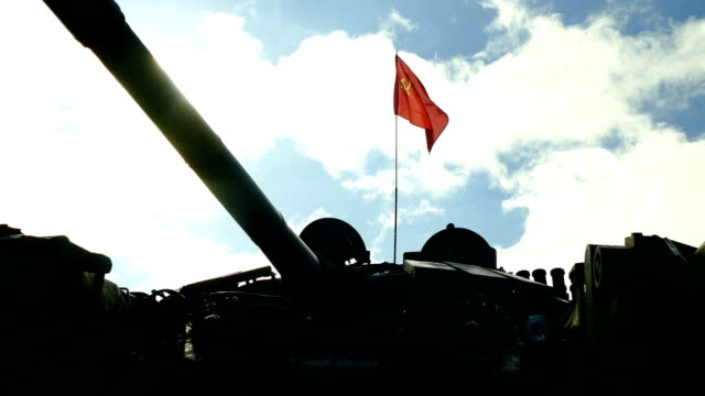 ussr flag over the silhouette of the soviet tank - communism stock videos & royalty-free footage