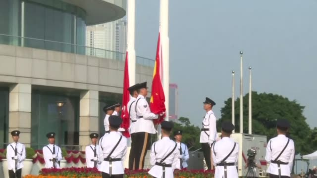 flag raising ceremony takes place in hong kong as china celebrates 70 years of communist rule with protests expected in the city later in the day - hong kong flag stock videos & royalty-free footage