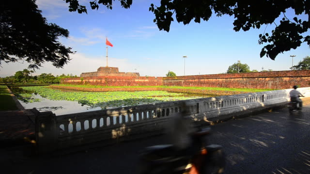 flag staff, imperial city, hue, vietnam with greenery and motorbike - fortress stock videos & royalty-free footage