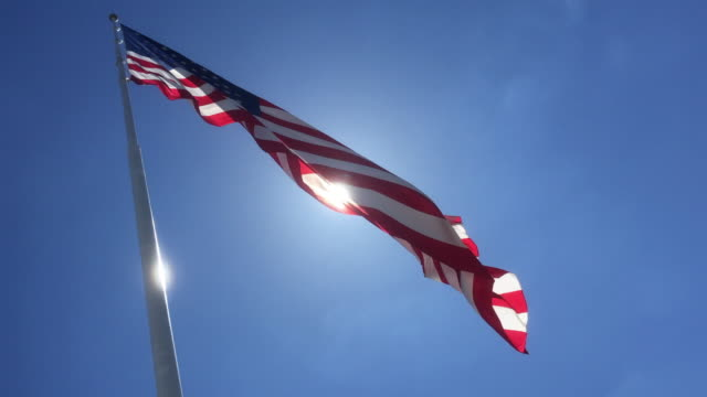 USA flag under sunlight