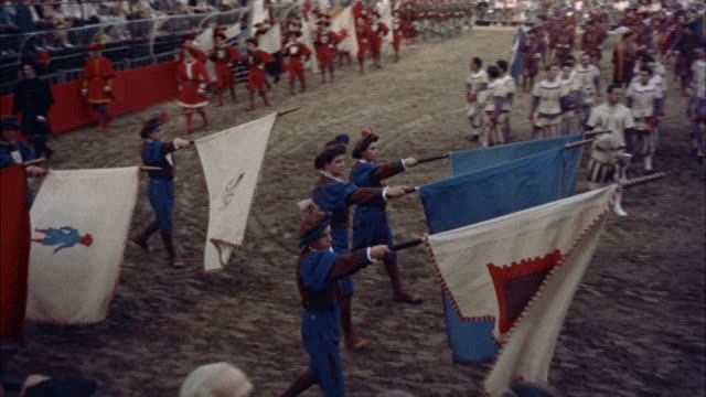 ws ts flag wavers on field  before football game / florence, italy  - anno 1954 video stock e b–roll