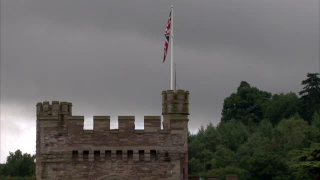 a flag waves above hampton court castle in herefordshire. available in hd. - herefordshire bildbanksvideor och videomaterial från bakom kulisserna