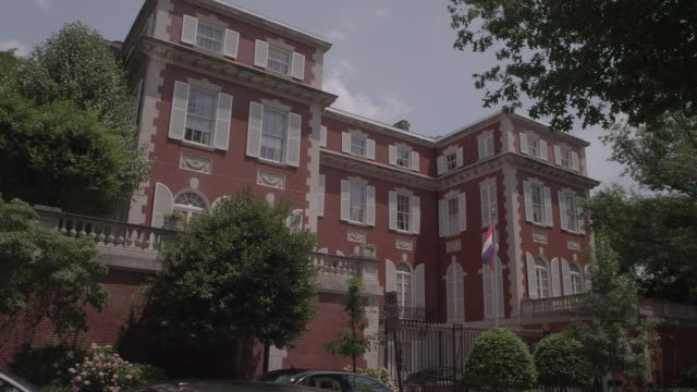 ws flag waves in front of building on embassy row / washington dc, united states - embassy stock videos and b-roll footage