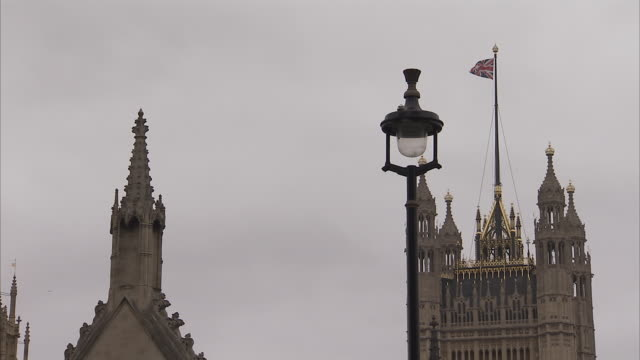 A flag waves in the breeze on top of Victoria Tower at the House of Lords in London. Available in HD.