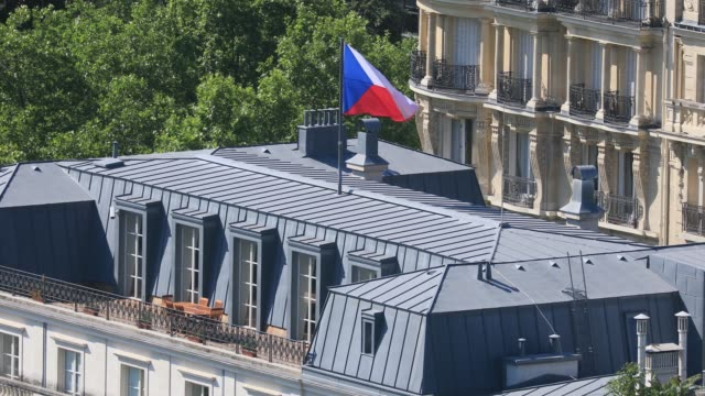 flag waves on the roof of the czech republic embassy in france on june 25, 2020 in paris, france. - 外交点の映像素材/bロール