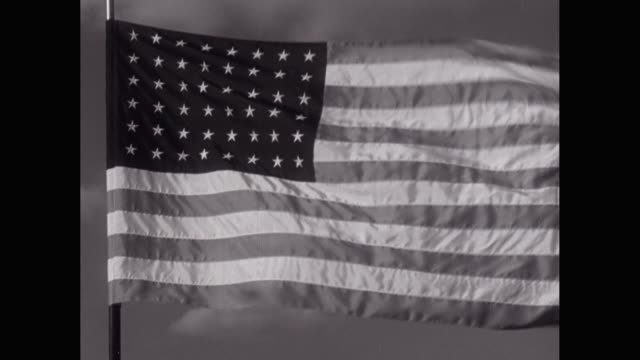 vídeos de stock, filmes e b-roll de ms us flag waving against sky / united states - bandeira norte americana
