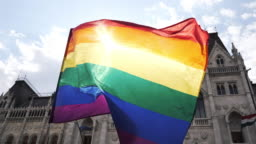 LGBT flag waving during the Pride rally  - slow motion video