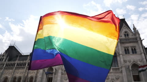 lgbt flag waving during the pride rally  - slow motion video - budapest stock videos & royalty-free footage