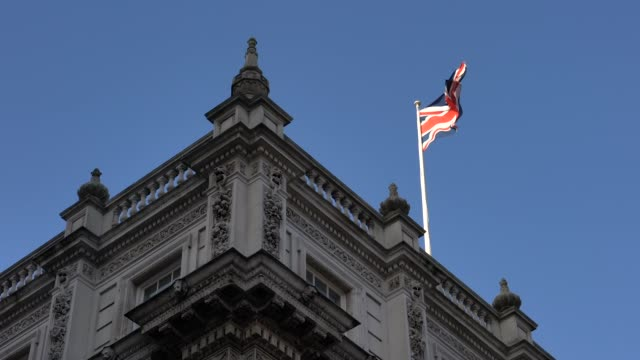 flag waving on top of the cabinet office building while pm boris johnson is at no. 10 downing street, in london, on dec. 13, 2019. - boris johnson stock videos & royalty-free footage