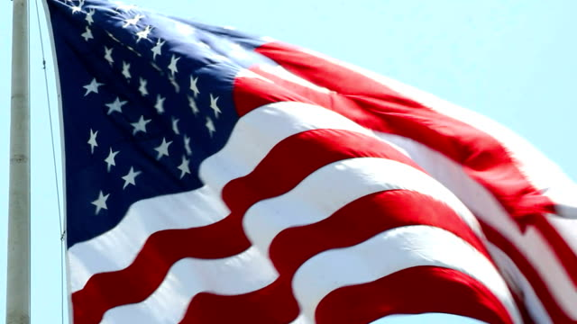 usa flag wawing in the wind in hd 1080pv - memorial event stock videos & royalty-free footage