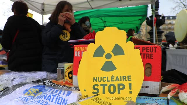 flag with the logo of radioactivity pictured during a rally to mark the 10th anniversary of the fukushima nuclear accident on march 11 in paris,... - radiazione video stock e b–roll