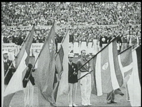 vidéos et rushes de pan flagbearers in olympic stadium at opening ceremonies / summer olympics berlin - 1936