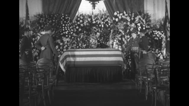 flag-draped coffin of franklin d. roosevelt, surrounded by flowers and military honor guard in east room of the white house / changing of the guard - funeral stock videos & royalty-free footage
