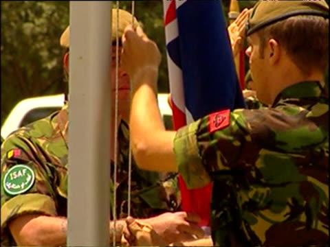 flaglowering ceremony for british marines leaving afghanistan end of war in afghanistan 2002 - 2001年~ アフガニスタン紛争点の映像素材/bロール