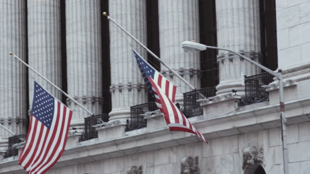flags above the new york stock exchange. - american culture stock videos & royalty-free footage